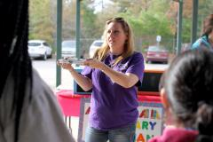 Stephen F. Austin State University senior EC-6 education major Christina Martin, of Franklin, Texas, explains to fifth grade students how to play her legendary librarian game. Recently, SFA teacher candidates from across Texas who are enrolled in SFA's online teaching field experience II course hosted a math career carnival for fourth and fifth grade students enrolled at Brooks-Quinn-Jones Elementary School in Nacogdoches.