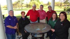 The Nacogdoches County Chamber of Commerce is working with Piney Woods Country Club to produce the 20th Annual Blueberry Golf Bash set for April 7. Pictured from left are golf planning committee members Ralph Ervin, event co-chairman Trish Holt, PWCC Board of Directors Howard Irion, Jim Boiles, Gary McEwen, and PWCC staff members Laura Varvel and Abby Lopez.