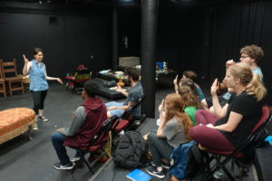 "Taylor Solice, Mesquite junior and dramaturg for the SFA SummerStage production of ""The Miracle Worker,"" helps theatre students learn sign language for their presentation of William Gibson's play based on Helen Keller's autobiography, ""The Story of My Life."""
