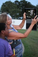 Utilizing an iPad and the Skyview app, Dr. Nola Schmidt, STEM Center curriculum coordinator, and Xavior Walker map out a constellation at the SFA Observatory.