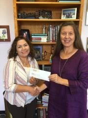 Dean of Stephen F. Austin State University's James I. Perkins College of Education Dr. Judy Abbott, right, presents Maria Landeros, a senior studying early childhood through sixth grade education, the 2017-18 McCathey Dressman Education Foundation Scholarship.