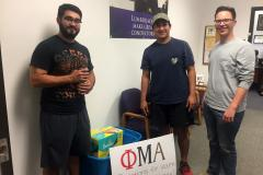 Stephen F. Austin State University students, from left, Jacob Rivas of The Colony, Gregory Garcia of San Antonio and Kenny Waldrop of Abilene assisted with collecting donations for storm victims. Members of Phi Mu Alpha Sinfonia, a national music fraternity dedicated to advancing music and inspiring musicians in America, collected the donations.