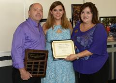 Natalie Clem of Memphis, Tennessee, is the first recipient of the Christopher J. Snyder Memorial Scholarship. Kim Luna, right, and Michael Munro, left, director of the visual impairment and orientation and mobility program at Stephen F. Austin State University, presented the award to Clem during a scholarship reception last week. Snyder, a two-time graduate of SFA's orientation and mobility program, was an assistive technology teacher and orientation and mobility specialist for Nacogdoches ISD, working with special-needs students throughout the district.