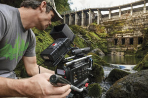 "Ben Knight films the former Elwha Dam before its removal from the Elwha River in Washington in a scene from ""DamNation."""