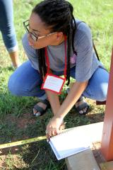 Stephen F. Austin State University interior design student Rebecca Washington measures the distance from a historical monument to the road with her classmates as they participate in a charrette, an intense design period. For three days, interior design students at SFA helped plan a new fire station for the Douglass Volunteer Fire Department.
