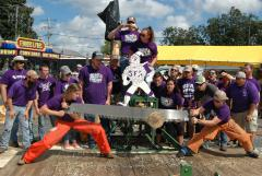 The Stephen F. Austin State University timbersports team, the Sylvans, won its third-consecutive collegiate title at the Arkansas State Lumberjack Competition held Oct. 6 and 7. Pictured, SFA forestry students Katie Adams, left, and Brody Capps, compete in the Jack and Jill Crosscut event. Their time of 6.61 seconds won the collegiate portion of the event.