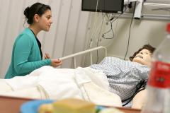 "Alexis Malquist, a Stephen F. Austin State University senior dietetics major from Grapevine, participates in a class project at SFA's DeWitt School of Nursing's Ed and Gwen Cole Simulation Lab. Malquist is using the skills she learned in her nutrition-counseling course to counsel her ""patient,"" a mannequin named Miss Hernandez."