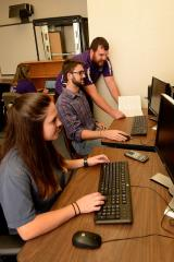 Dr. Brian Barngrover, Stephen F. Austin State University assistant professor of biochemistry and chemistry, oversees Russell Stager, senior chemistry student, and Alaina Spurr, senior biochemistry student, with their research on latent fingerprinting techniques. Stager and Spurr are attempting to determine the chemical reactions that occur during the fingerprinting process using computational chemistry, a method that relies on computers to determine energy reactions.