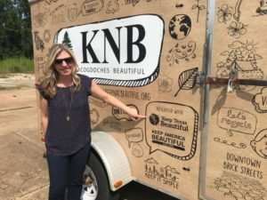 Christine Chute Canul, former Keep Texas Beautiful (KTB) Program Director, points out the KTB logo on the new Keep Nacogdoches Beautiful trailer during a KTB regional training held in Nacogdoches.