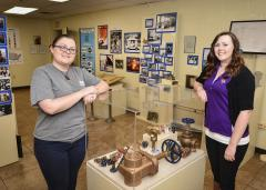 Stephen F. Austin State University public history graduate students Amanda Saylor (left) and Laura Turner joined with NIBCO, a 111-year-old valve, fittings and flow control products company, to research, design and create an exhibit to celebrate the 75th anniversary of NIBCO's Nacogdoches plant.