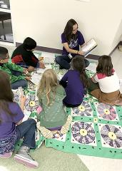 """Stephen F. Austin State University students studying elementary education recently hosted a """"We Need Diverse Books"""" event at the SFA Charter School to promote diversity in literature. During the event, SFA students read a book about a diverse topic to a group of Charter School students and also engaged the students in an activity related to the reading."""