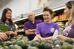During a grocery store tour, Stephen F. Austin State University students educate faculty and staff members on nutrition as part of the Share Our Strength's Cooking Matters Program. Through this six-week program, SFA students give lectures and cooking demonstrations to participants.