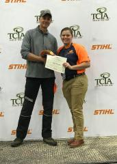 Lana Welford, a senior urban forestry major at Stephen F. Austin State University's Arthur Temple College of Forestry and Agriculture, won the Women's Collegiate Work Climb title at the 2017 Tree-Care Industry Association Expo held in Columbus, Ohio. Welford, pictured right, accepts a certificate from Mark Chisholm, a world-renowned urban forester and competitive tree climber.