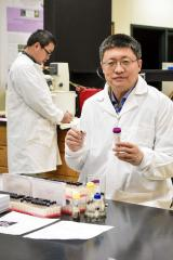 A team of researchers, including Dr. Shiyou Li, pictured, research professor and director of the National Center for Pharmaceutical Crops at Stephen F. Austin State University, recently received a U.S. patent for Salvinol, a compound derived from the invasive giant salvinia plant. Lab trials conducted at the NCPC show Salvinol can slow and, in some cases, completely inhibit the growth of a wide range of cancer cells, including pancreatic and lung cancer cells.