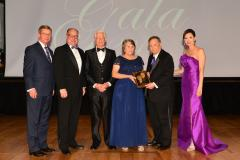 The late Madeline and Alfred Danheim were inducted into the Fredonia Society Saturday during SFA's 29th annual Gala. Pictured, from left, are David Alders, SFA Board of Regents chair; Jimmy Mize, SFASU Foundation Board of Trustees chair; family members Lamar Lilly and Candace Hughes; Dr. Baker Pattillo, SFA president; and Jill Still, SFA vice president for university advancement.