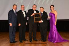 ExxonMobil was inducted into the Stephen F. Austin Society Saturday during SFA's 29th annual Gala. Pictured, from left, are David Alders, SFA Board of Regents chair; Jimmy Mize, SFASU Foundation Board of Trustees chair; Truman Bell, headquarters community relations manager at ExxonMobil; Dr. Baker Pattillo, SFA president; and Jill Still, SFA vice president for university advancement.