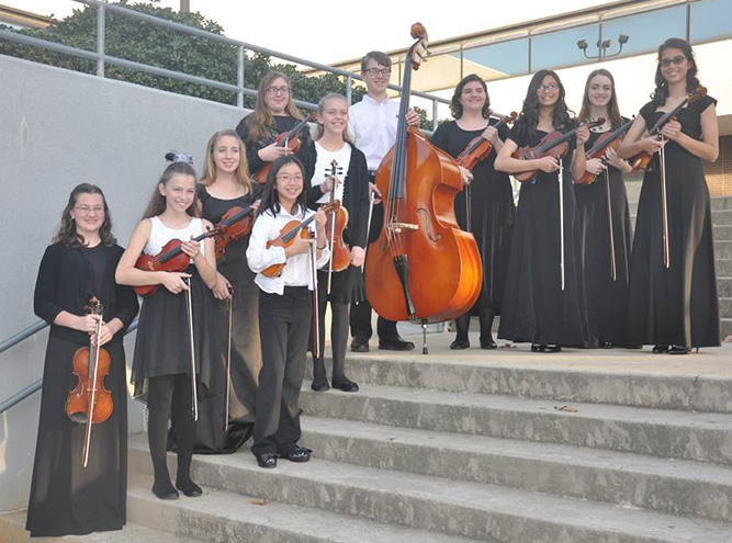 Ryan Ross conducted the high school orchestra at last fall's Regions 4 and 21 clinic and concert at Longview High School.