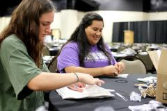 Stephen F. Austin State University interior design senior Calli Blankenship of Livingston, left, and hospitality administration senior Yessenia Ramirez of Houston help prepare silverware for the annual Chairished Blessings fundraiser, which took place Feb. 2 at the Nacogdoches Exposition and Civic Center. More than 100 students in SFA's School of Human Sciences helped coordinate this event, which benefited the nonprofit Christian organization Love in the Name of Christ.